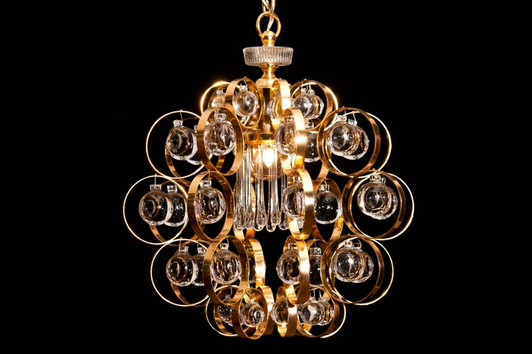 Beautiful chandelier by Palwa Germany. This amazing lamp is made of gilded brass with Murano glass elements. It is in a wonderful condition.  Period 1960s Dimensions H 58 cm, ø 40 cm.