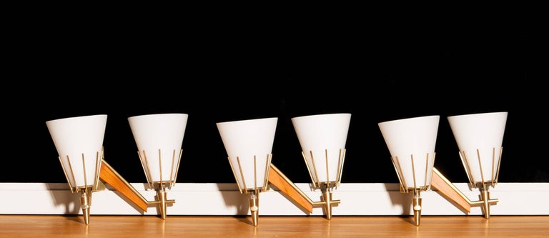 Mid-Century Modern Set of Three Midcentury Brass And Teak Wall Lights / Wall Scones by Stilnovo For Sale