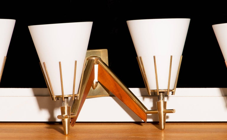 Mid-20th Century Set of Three Midcentury Brass And Teak Wall Lights / Wall Scones by Stilnovo For Sale