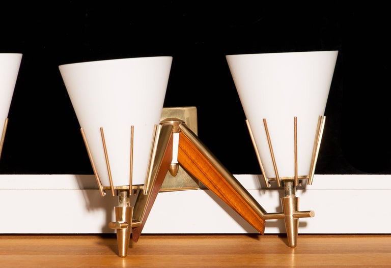 Set of Three Midcentury Brass And Teak Wall Lights / Wall Scones by Stilnovo For Sale 1
