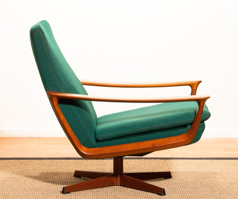 Extremely rare teak swivel chair by Johannes Andersen for Trensums, Denmark. 