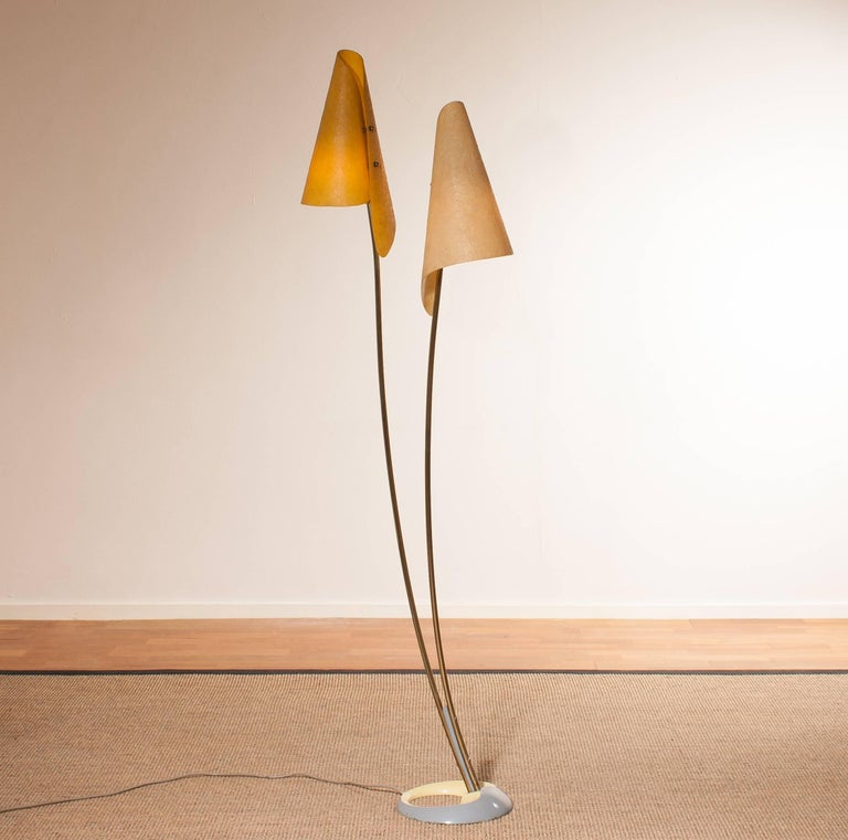 Very rare and beautiful floor lamp with two fibreglass shades and a wonderful design stand. This very nice design is made in Germany. It is in a very good and working condition. Period 1960s. Dimensions: H 164 cm, W 46 cm, D 25 cm.