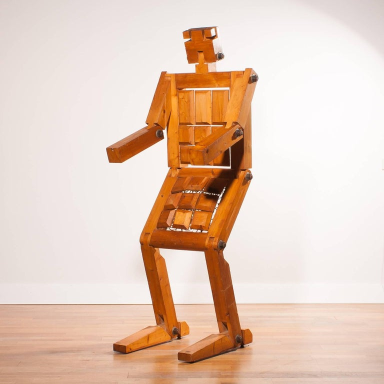 Really an 'eyecatcher' this robot chair. The chair is signed with 'Bielke 77'. It is made of pinewood within the back and seat large solid springs and secured with large bolts. The robot can also stand and is then 180 cm high. A great decorative