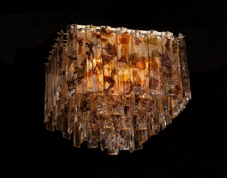 Stunning Italian Mid-Century Modern squared ceiling lamp by Mazzega. 95 pieces of clear crystal elements measuring 28cm each. The glass hangs on hooks and pins onto a white lacquered metal frame, as pictured. The elements have three colored crystal