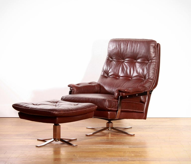 Beautiful high-quality leather lounge chair and ottoman designed by Arne Norell and produced by Vatne Møbler.