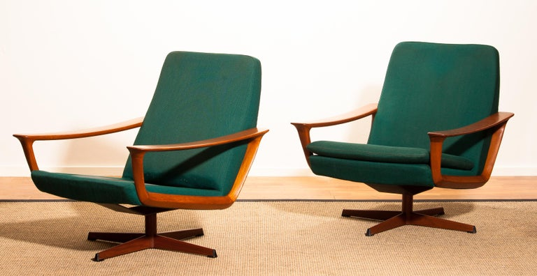 Extremely rare teak swivel chair by Johannes Andersen for Trensum, Denmark.  The chair to the right is in excellent condition.  Upholstery and padding shows wear consistent with age and use. The chair to the left is also in perfect condition except