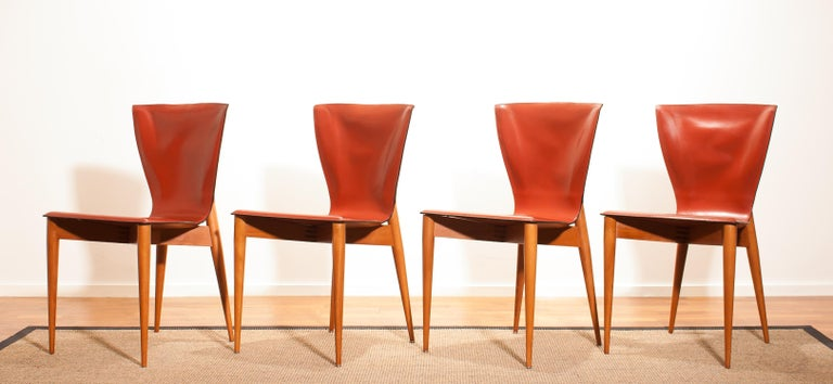 This set of four Mid-Century Modern chairs were designed by Carlo Bartoli and made by Matteo Grassi. They are made of hardwood frames with cognac brown Italian leather seats and backs. The set is in a wonderful condition. Period,