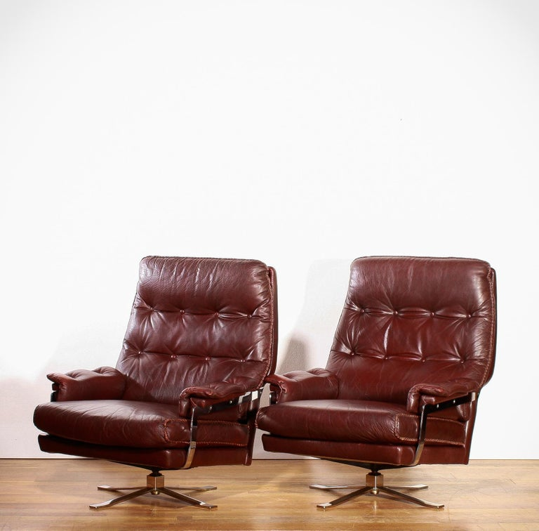 Mid-20th Century 1960s, Chrome and Leather Swivel Lounge Chairs and Ottoman by Arne Norell For Sale