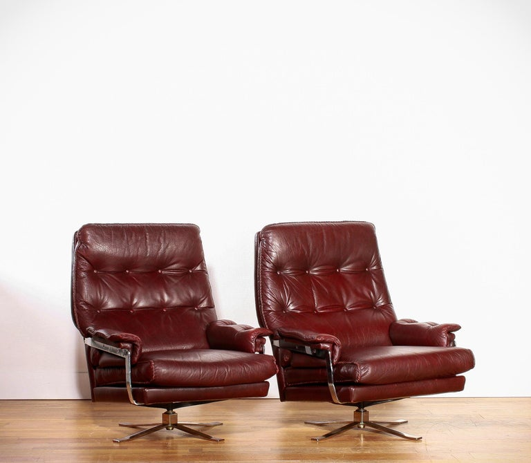 Steel 1960s, Chrome and Leather Swivel Lounge Chairs and Ottoman by Arne Norell For Sale