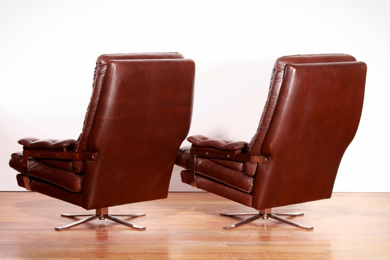 1960s, Chrome and Leather Swivel Lounge Chairs and Ottoman by Arne Norell For Sale 4