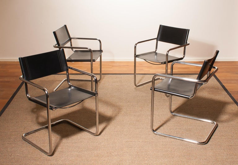 A beautiful set of four dining chairs made by Matteo Grassi, Italy. The chairs have tubular chrome steel frames with sturdy black leather seating and backrest. They are signed on the back of the backrest. The chairs are in very nice