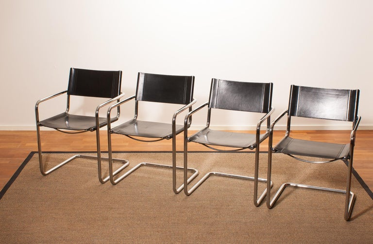 Italian Tubular Steel Chrome and Sturdy Black Leather Dining Chairs by Matteo Grassi For Sale