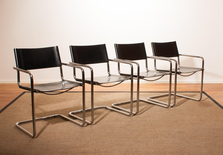 Late 20th Century Tubular Steel Chrome and Sturdy Black Leather Dining Chairs by Matteo Grassi For Sale