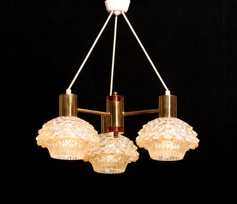 Swedish 1950s, Brass and Glass Chandelier by Carl Fagerlund for Orrefors For Sale