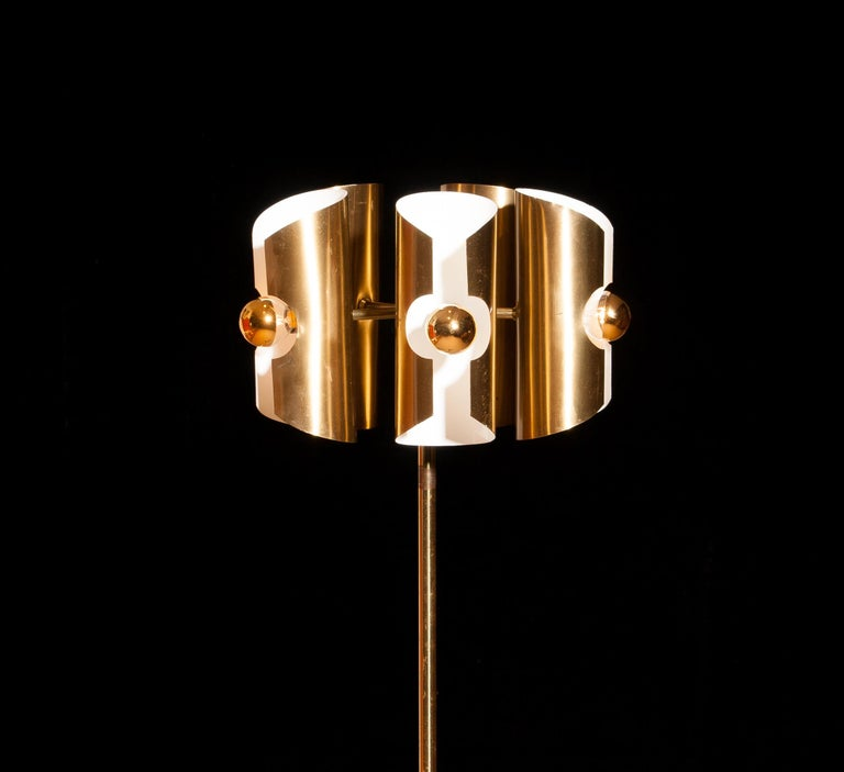 Beautiful 1960 Italian floor lamp in brass.  The shades are fixed and made of brushed brass.  The shades are height 21 cm. and ø 9 cm.  Inside the shades are white lacquered for proper reflection. The floor lamp has traces of rust, dents and