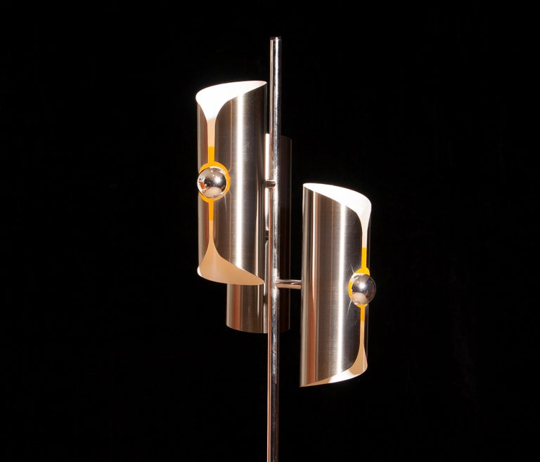 Beautiful 1970 Italian floor lamp in chrome and steel combined with a total height of 160 cm. The shades are fixed and made of brushed steel.  The shades are height 28 cm. and ø 9 cm.  Inside the shades are white lacquered and in the middle part