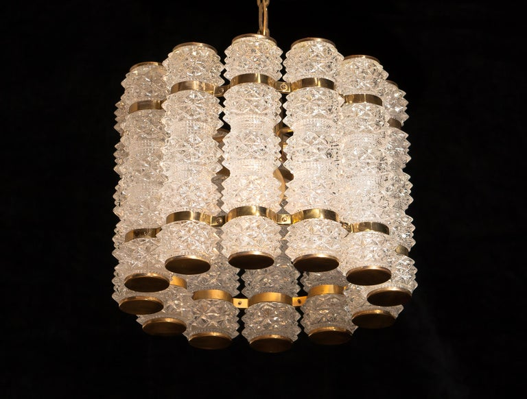 Swedish 1960s, Brass and Crystal Cylinder Chandelier by Tyringe for Orrefors, Sweden For Sale