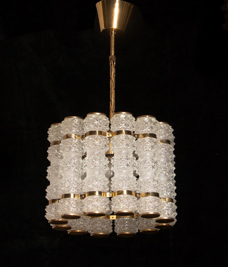 Mid-20th Century 1960s, Brass and Crystal Cylinder Chandelier by Tyringe for Orrefors, Sweden For Sale