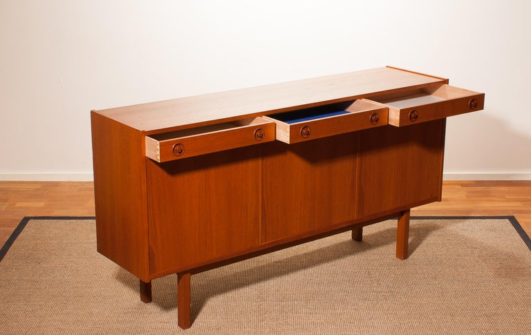 Beautiful sideboard produced by Brexo Möbler, Sweden. This cabinet is made of teak and has three drawers and three doors. It is in a very nice condition. Key included. Period 1950s Dimensions: H 90 cm, W 170 cm, D 42 cm.