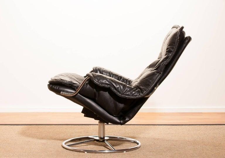 1970s Black Leather Swivel Chrome Steel Lounge Chair