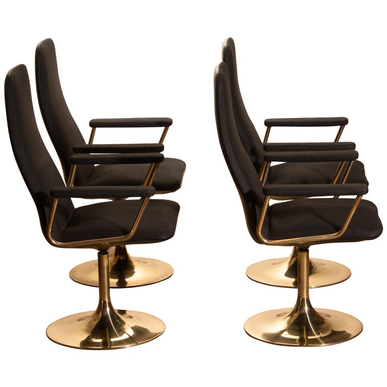 Four Golden, with Black Fabric, Armrest Swivel Chairs by Johanson Design, 1970 For Sale