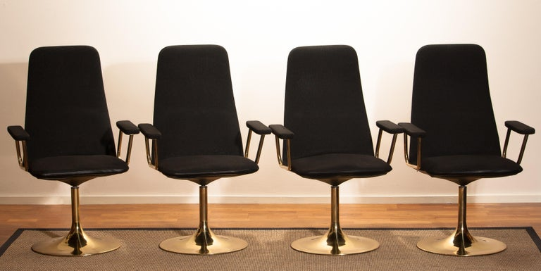Late 20th Century Four Golden, with Black Fabric, Armrest Swivel Chairs by Johanson Design, 1970 For Sale
