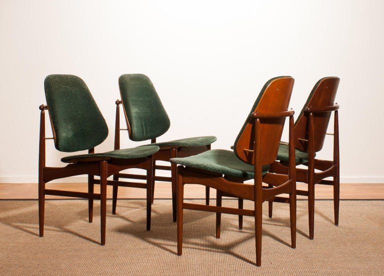 Beautiful set of four Arne Vodder design armchairs made by France & Daverkosen, Denmark. Seat and back covered in original bottle-green velvet fabric. These chairs sit extremely comfortable and are beautifully finished with beautiful bronze
