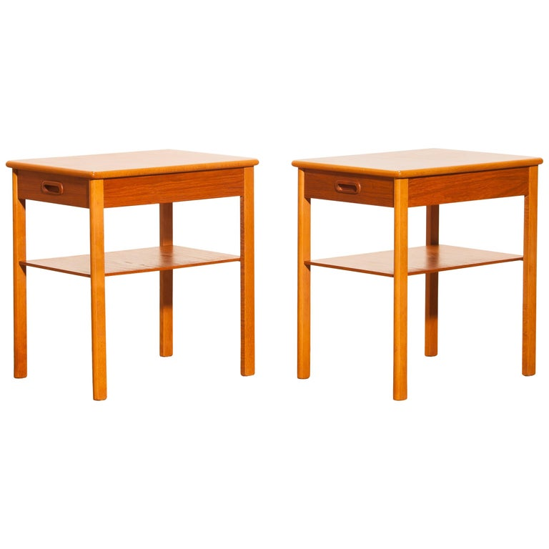 Beautiful pair of bedside tables by Säffle, Sweden. These tables are made of teak and they have a drawer. They are in very nice condition. Period 1950s. Dimensions: H 52 cm, W 36 cm, D 48 cm.
