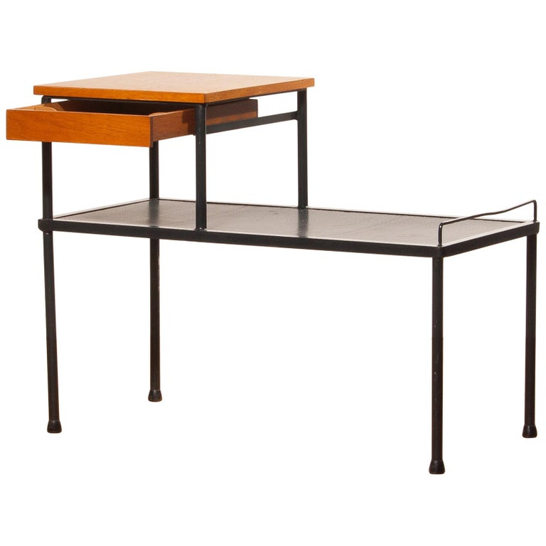 Very nice side table, bench or telephone table. This table is made of black lacquered metal and has a teak writing space with a drawer. It is in a lovely original condition. Period 1950s. Dimensions: H 62 cm, W 78 cm, D 40 cm.
