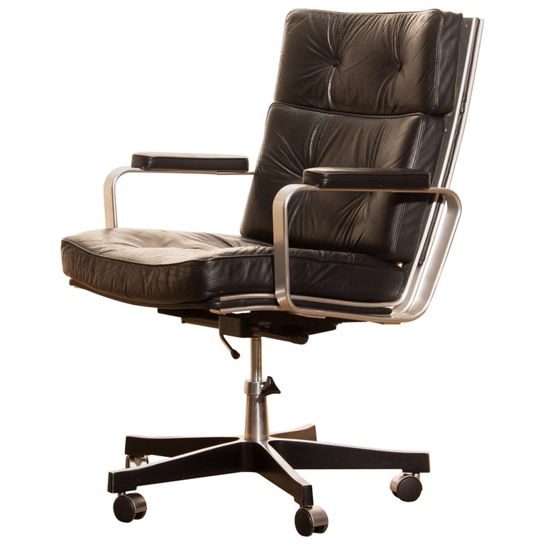 Beautiful adjustable office chair designed by Karl Erik Ekselius for JOC Design. The nice thick solid black leather with an aluminium frame on wheels all in good condition. The chair is extremely comfortable and newly filed.  Period: