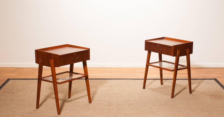 A pair of lovely teak bedside tables.