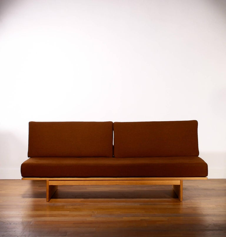 In absolute top condition sleeper or daybed in oak and dark brown wool.