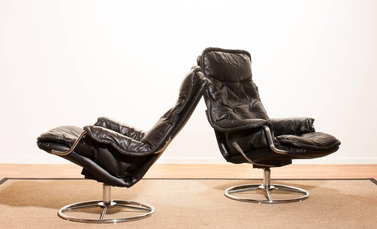 1970s, a Pair of Black Leather Swivel Chrome Steel Lounge Chairs , Sweden For Sale 1