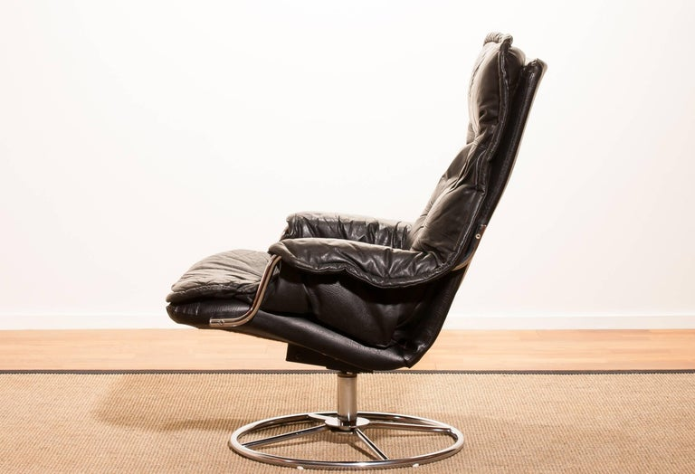 Swedish 1970s, Black Leather Swivel Chrome Steel Lounge Chair , Sweden For Sale
