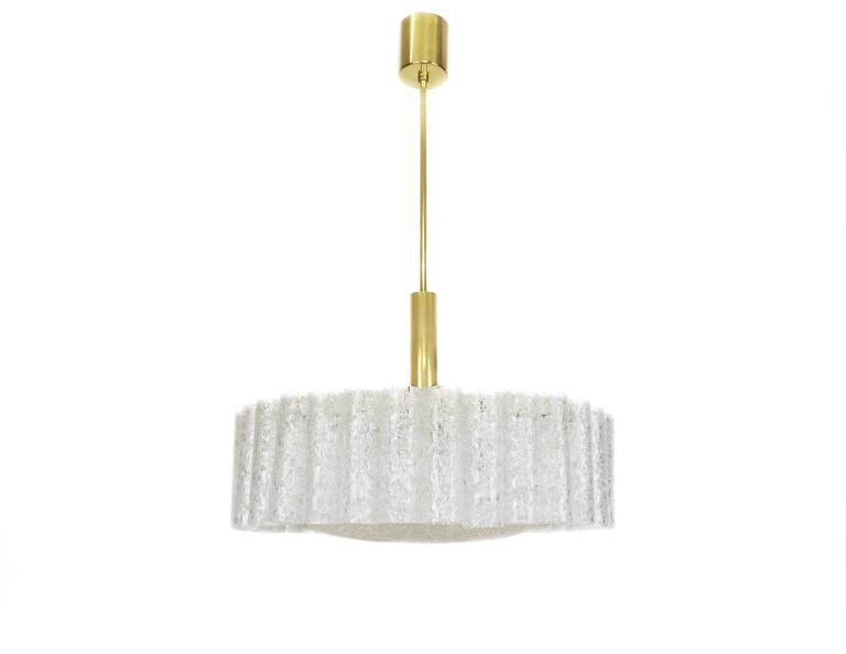Beautiful chandelier with Murano glass tubes brass surrounding a brass ring, by Doria, Germany, manufactured, circa 1960-1969.  Sockets: Six x E14 candelabra bulbs  and function on voltage from 110 till 240 volts. (for USA - UK - etc ..). Drop rod