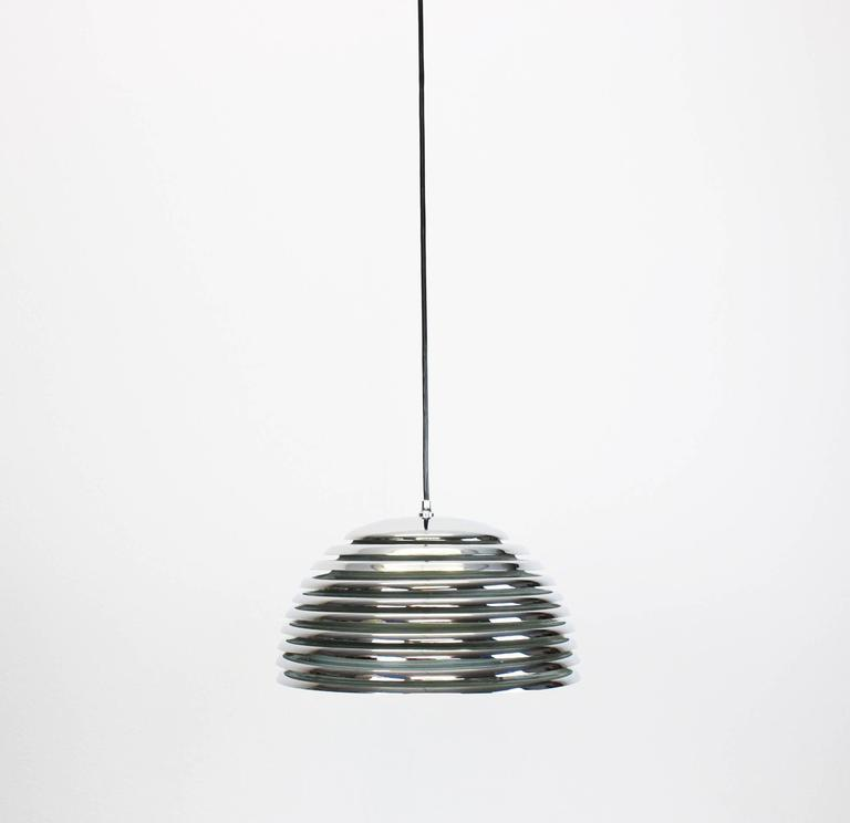 Very nice pendant light with chrome rings, designed by Kazuo Motozawa for Staff Leuchten manufactured in Germany, circa the 1970s.  High quality and in very good condition. Cleaned, well-wired and ready to use.   The fixture requires 1 x E27