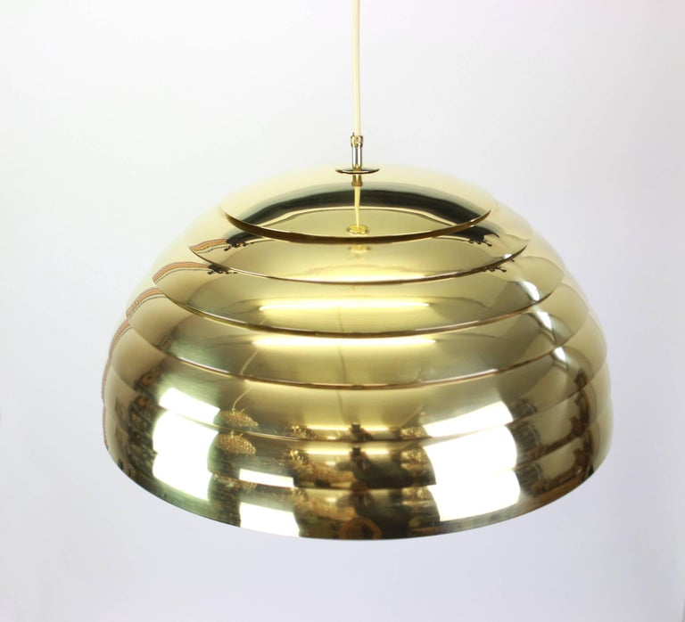 Large brass pendant light designed by Florian Schulz, Germany, 1970s.  High quality and in very good condition. Cleaned, well-wired and ready to use.   The fixture requires one Standard bulb and is compatible with the US/UK/ etc .. standards.  The
