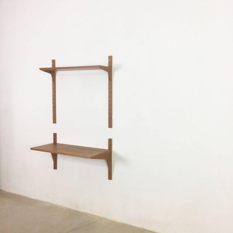Article:  wall unit teak wood Cado system.     Designer:  Poul Cadovius  Producer:  Cado, Denmark    Description:  Original Danish wall unit designed by Poul Cadovius in the 1950s for Cado, Denmark. This listed unit was produced