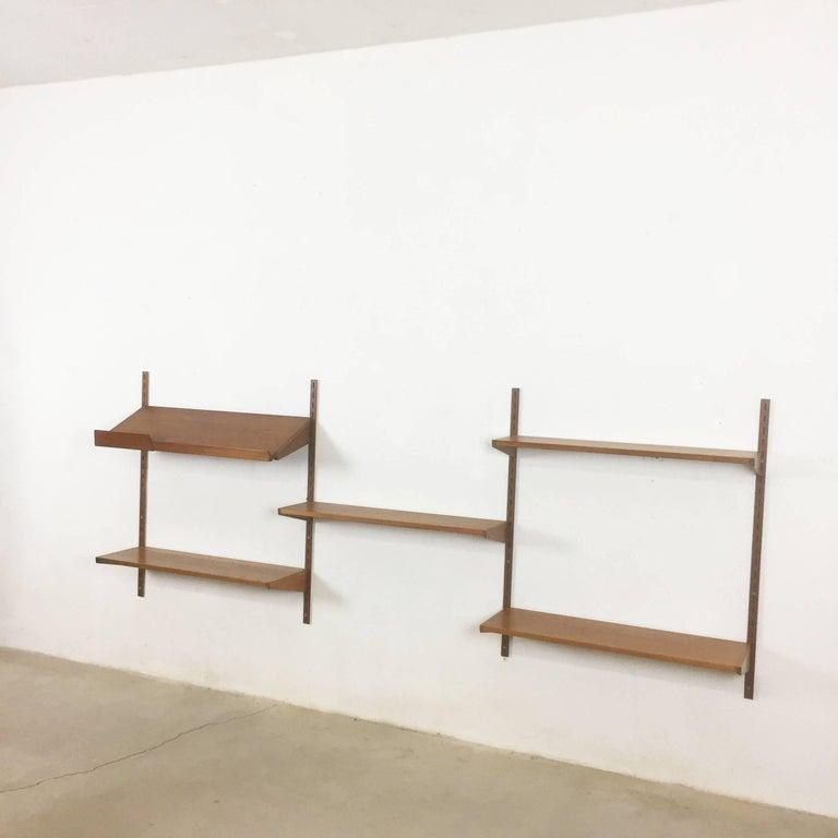 Article:  Wall unit teak wood.    Designer:  Kai Kristiansen.   Producer:  FM Feldballes Mobelfabrik, Denmark.    Description:  Original Danish wall unit designed by Kai Kristiansen in the 1950s for Feldballes Mobelfabrik,