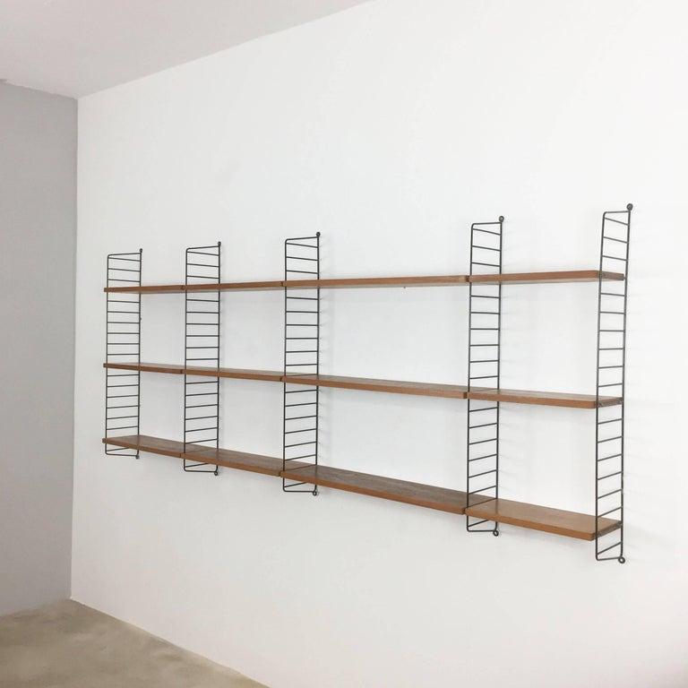 String Regal wall unit  Made in Sweden  Bokhyllan 'The Ladder Shelf'  Design: Nils und Kajsa Strinning, 1949  The architect Nisse Strinning was born in 1917. From 1940 to 1947 he studied architecture in Stockholm, before he designed the
