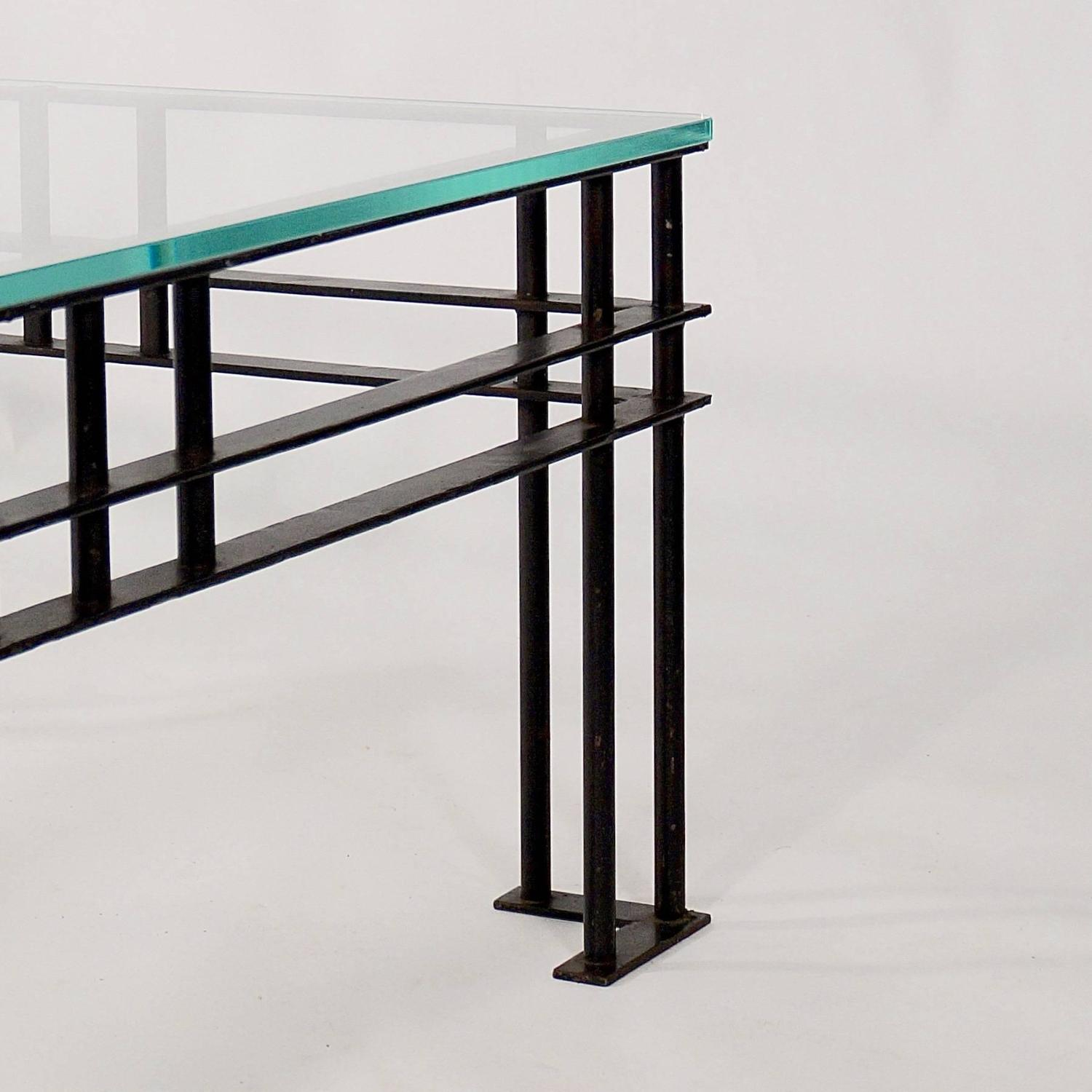 Glass Top Coffee Table With Iron Base: Rectangular Coffee Table With A Black Iron Base And Glass