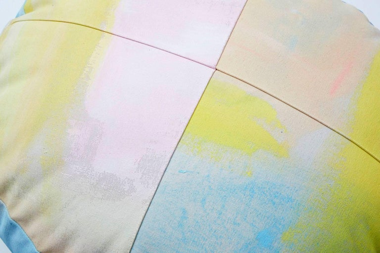 For Fort Makers, Naomi Clark paints vibrant abstract compositions on fabrics that are then made into useable objects. Each hand-painted cotton canvas circular ottoman is a completely unique piece of art and can be customized according to customers'
