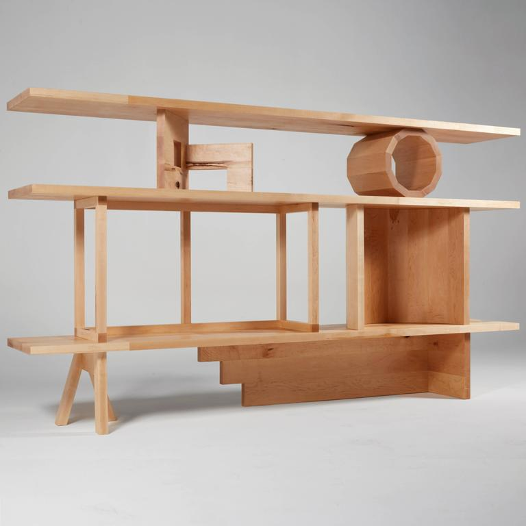Stack Shelving Unit is a grouping of architectural and abstract sculptures by Noah Spencer that together make a shelving unit. When these sculptures are moved around and used in different positions to hold up shelving planks, they create multiple