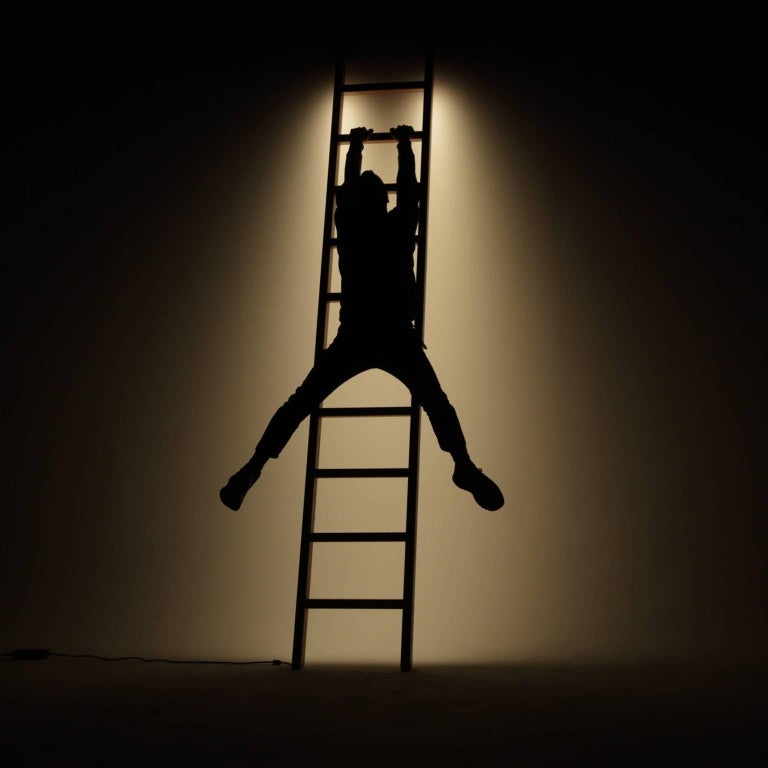 Fort Makers' Ladder Line Light is made in Brooklyn by Noah Spencer. This sculptural LED light juxtaposes hard lines with soft reflected light and emits an ambient aura. The lifespan of an LED strip is approximately 50,000 hours.