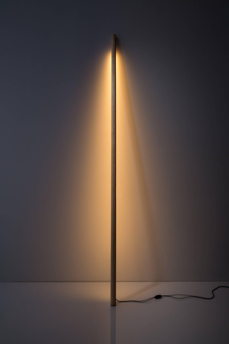 Fort Makers' Maple Line Light is made in Brooklyn by Noah Spencer. This sculptural LED light juxtaposes hard lines with soft reflected light and emits an ambient aura. The lifespan of an LED strip is approximately 50,000 hours. 12 volts LED light,