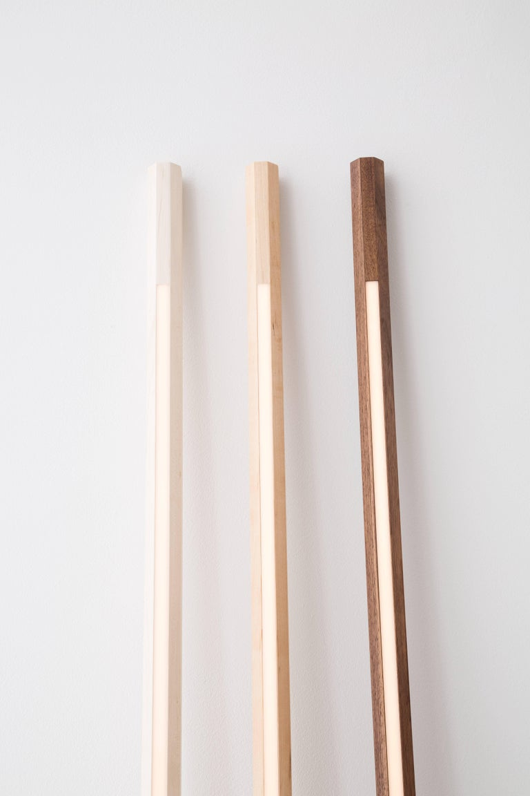 Fort Makers' Bleached Maple Line Light is made in Brooklyn by Noah Spencer. This sculptural LED light juxtaposes hard lines with soft reflected light and emits an ambient aura. The lifespan of an LED strip is approximately 50,000 hours. 12 Volts LED