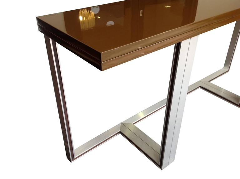 An Artelano Brown Gloss Lacquer Extending Console Table, With Aluminium  Legs With Rosewood Inlay.