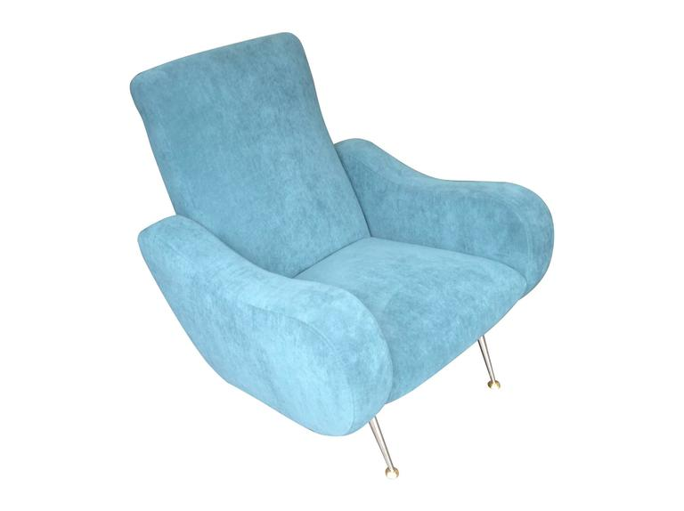An unusual and very comfortable Gio Ponti style Italian armchair with brass legs, newly re-upholstered in blue fabric.