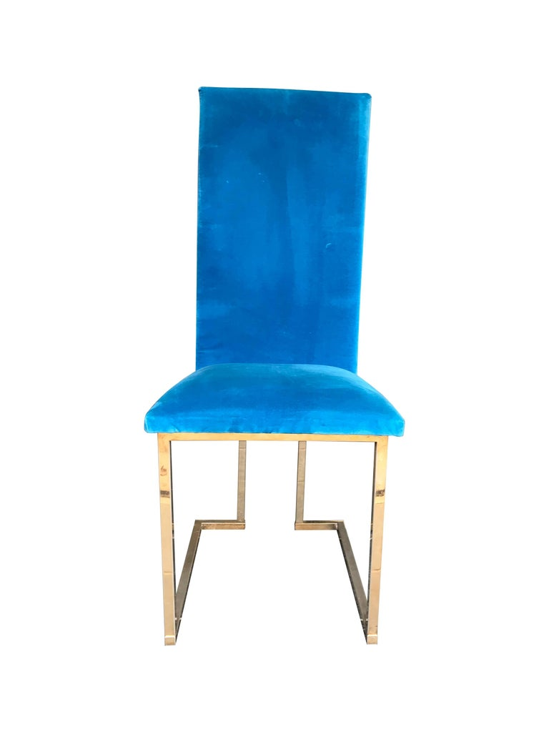 A set of 4 Willy Rizzo dining chairs with gilt metal frames and upholstered in stunning turquoise velvet.