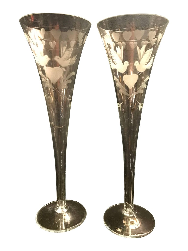 Beautiful, vintage, engraved French champagne flutes. Each engraved with two doves holding a love heart, also with love hearts around the rim. All in perfect condition and available individually, 11 available. Perfect for wedding, engagement, or